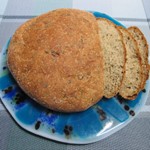 Fresh bread loaf on fused glass plate