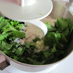Combining mustard greens with dough by using a Kitchen Aide mixer