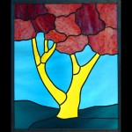 Stained glass panel portraying cherry tree