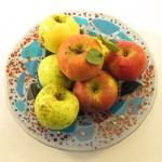 speckled pasta bowl with yellow and red apples