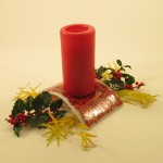 Red & orange blend candle-bridge with holly & yellow weed