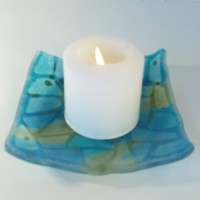 Kiln-worked glass plate with candle