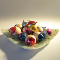 Colorful Christmas ornaments on small glass platter