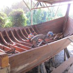 Master boatmaker's son at work
