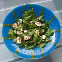 Spinach salad in fused glass bowl